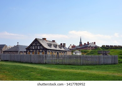 Louisbourg, Canada - July 30, 2016:  Period buildings at the Fortress of Louisbourg, which was restored to resemble how the French colony looked in the 1700s.