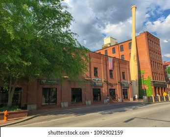 Louisville, KY—May 9, 2018; entrance to  Louisville Slugger visitor center and brick factory with giant bat.  Louisville Slugger is the largest producer of wooden baseball bats for major league teams