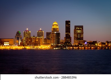 Louisville, Kentucky skyline and Ohio River at dusk