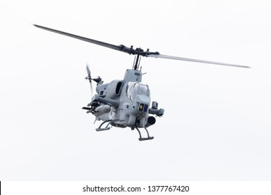 Louisville, Kentucky, USA - April 13, 2019: Thunder Over Louisville, United States Marine Corps ah-1 Cobra Attack helicopter performing a fly by over the Ohio River