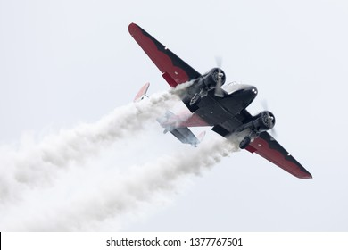 Louisville, Kentucky, USA - April 13, 2019: Thunder Over Louisville, Twen Beech aircraft performing aerobatic display over the Ohio River