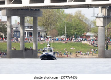 Louisville, Kentucky, USA - April 13, 2019: Thunder Over Louisville, Louisville Metro police boat patroling the ohio river during the festival and airshow