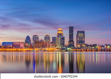 Louisville, Kentucky, USA downtown skyline at the river at dusk.
