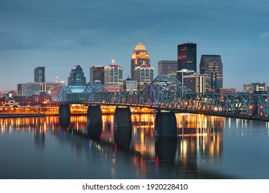 Louisville, Kentucky, USA downtown skyline on the Ohio River at dusk. - Shutterstock ID 1920228410