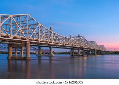Louisville, Kentucky, USA with John F. Kennedy Memorial Bridge spanning the Ohio River at dusk. - Shutterstock ID 1916201005