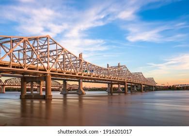 Louisville, Kentucky, USA with John F. Kennedy Memorial Bridge spanning the Ohio River at dusk. - Shutterstock ID 1916201017