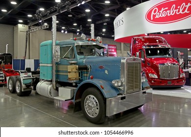 Louisville, Kentucky, USA - March 21, 2018: Historic and modern Peterbilt truck at the MATS 2018, Louisville, Kentucky