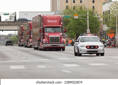 Louisville, Kentucky, USA - May 03, 2018: The Pegasus Parade, Semi-Truck Carrying the Budweiser Clydesdales, being scorted by police car down W Broadway street