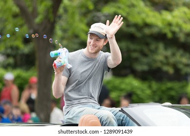Louisville, Kentucky, USA - May 03, 2018: The Pegasus Parade, brian macdonald, member of the judah and the lion, music band, on a coervette, going down W Broadway