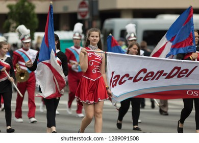 Louisville, Kentucky, USA - May 03, 2018: The Pegasus Parade, Members of the Jac-Cen-Del cheerleaders and Marching band from Osgood Indiana