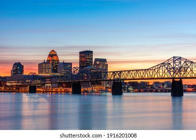 Louisville, Kentucky, USA skyline on the river at dusk. - Shutterstock ID 1916201008