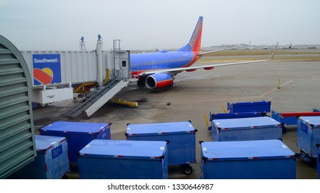 Louisville, KY - January 17th, 2019: A Southwest Airlines Boeing 737 Parked at a Gate at Louisville's Standiford Field with Luggage Carts