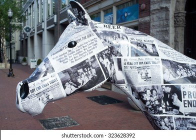 Louisville, KY - May 30: Statue of horse covered with newspapers announcing the end of prohibition on West Main Street, downtown Louisville, Kentucky. Public art celebrating distilling history.