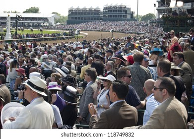 LOUISVILLE, KY - MAY 4: The crowd at the Kentucky Derby, pictured on May 4, 2010 in Louisville, Kentucky, intently watches the 136th running of the derby.