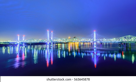 Louisville KY Skyline at dawn featuring the Lincoln and Kennedy Bridges .