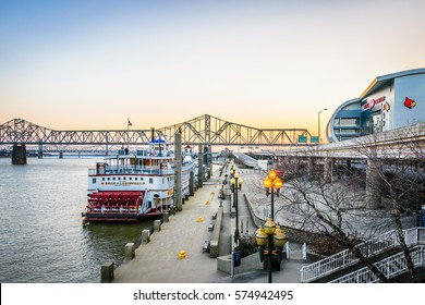 LOUISVILLE, KY, USA - FEB 5, 2017: Sunrise at the Louisville KY Waterfront Park Wharf and the KFC Yum! Center. The wharf is home to the Belle of Louisville Steamboat.