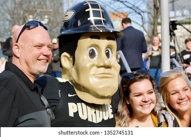 Louisville, KY / USA - March 28, 2019: March Madness Sweet 16 at the KFC Yum Center.  Fans getting their picture taken with Purdue Pete.