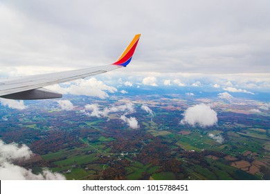 LOUISVILLE, KY, USA - October 24, 2017: Flying over the state of Kentucky with looking out of a Southwest Airlines airplane.