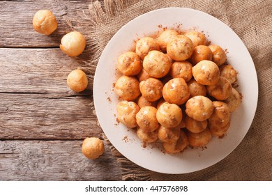 loukoumades donuts with honey and cinnamon close-up on a plate. Horizontal view from above