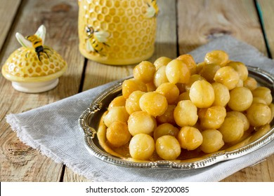 Loukoumades donuts with honey and cinnamon. Hanukkah celebration concept. Copy space.