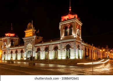 LOULE, PORTUGAL - CIRCA MAY 2018: The markethall in the old town of Loule at night. Algarve, Portugal.