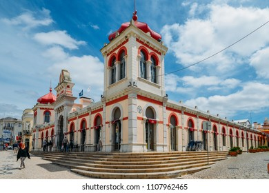 Loule, Portugal - June 4, 2018: Moorish architectural facade of the traditional market consisting of family run stalls selling local grown or sourced produce which include fish, fabrics and gifts