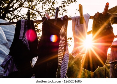 loundry drying rack in a rural area with sunburst coming trough