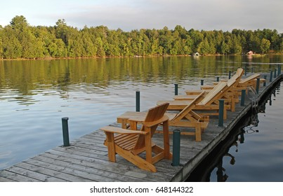 Lounge chairs await their first occupants on a northern Wisconsin lake.