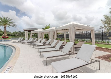 Lounge chairs with cabana in a community resort pool