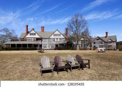 Lounge chairs and English country house.  The Mansion is Located at Bayard Cutting Arboretum State Park on Long Island, New York.