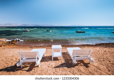 lounge chairs on beautiful tropical beach at Egypt, Dahab