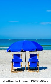 Lounge chairs and umbrella along popular Fort Myers Beach on the west coast of Florida.