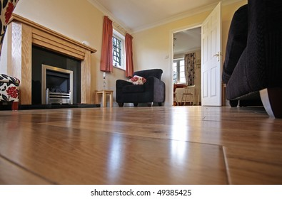Lounge in UK home showing laminate floor