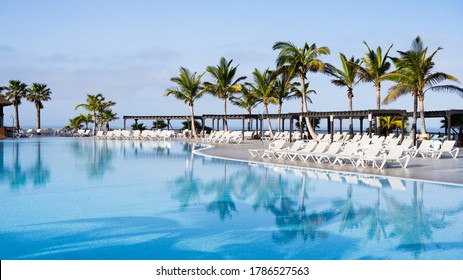 Loungers round an empty swimming pool at the beginning of the Coronavirus lockdown in Spain. Severe problems for tourist business in Spain.