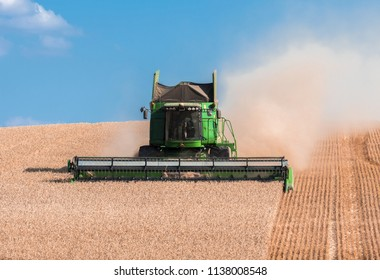 Louny – July 19, 2018: Harvesting of wheat field with John Deere combine, Louny – July 19, 2018, CZECH REPUBLIC
