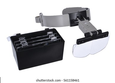 Loupe glasses jewelry on a white background. A magnifying glass on the head. Closeup view of some magnifying loupes for dentists or watchmakers.