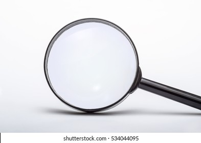 Loupe or Magnifying Glass on Gray Background