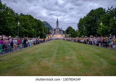Lourdes, France; August 2013:   Pilgrims partaking in La Procession Mariale Aux Flambeaux or the Torchlight Marian Procession in Lourdes.