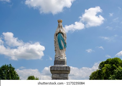 Lourdes, France; August 2013: Statue of Our Lady of Immaculate Conception. Lourdes, France, major place of catholic pilgrimage.