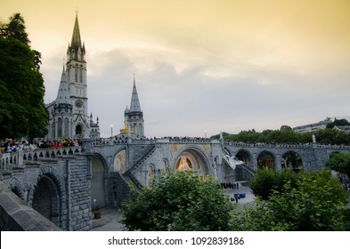 Lourdes / France - july 17 2011: People waiting for the mary procession with candles every evening in Lourdes.