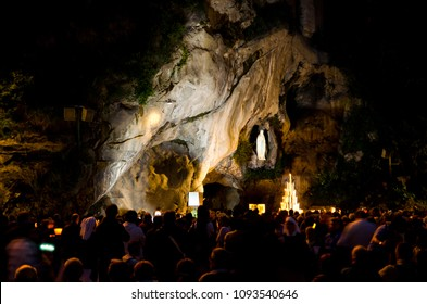 Lourdes / France - july 18 2011: Grotto in Lourdes, France, by night where Bernadette Soubirous saw a vision ot the Virgin Mary in a cave called Massabielle near the Gave river.