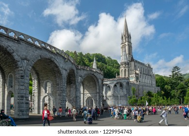 Lourdes, Midi-Pyrénées, France; June 2015:  The Basilica of Our Lady of Immaculate Conception of Lourdes is built on the top of the rock above the Grotto