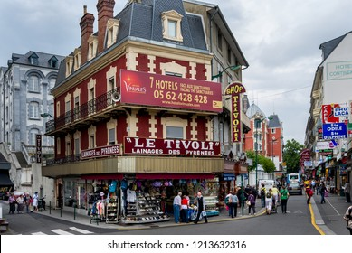 Lourdes, France - May 13, 2011: People shopping for religious items in the many shops lining the streets of Lourdes.