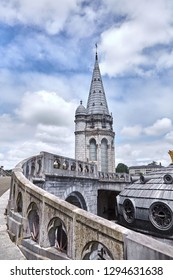 Lourdes, France: The Sanctuary of Our Lady of Lourdes is one of the largest pilgrimage centers in Europe. Detail of the architecture of the basilica
