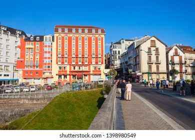 LOURDES, FRANCE - SEPTEMBER 19, 2018: Lourdes is a small market town lying in the foothills of the Pyrenees.