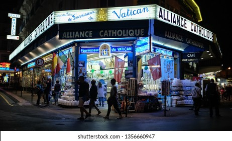 Lourdes, French, Sept 21 2018: One of the typical religious shop in Lourdes, light up the night in the famous street in Lourdes