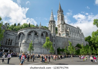 Lourdes, Midi-Pyrenees, France; June 2015:  The Basilica of Our Lady of Immaculate Conception of Lourdes is built on the top of the rock above the Grotto