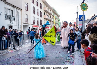 "LOURES, PORTUGAL - CIRCA MARCH 2019:  Carnival Festivities (parade) in Loures, Lisbon. A group of ""big heads"" who interacts with the audience."