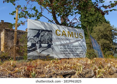 LOURMARIN, FRANCE - SEPTEMBER 1, 2020. At the entrance of the Château, a stretched canvas announces a photographic exhibition of Albert Camus, writer, philosopher, novelist among others.