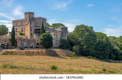 LOURMARIN, FRANCE - SEPTEMBER 1, 2020. The architectural ensemble of the Château de Loumarin. Blue sky.